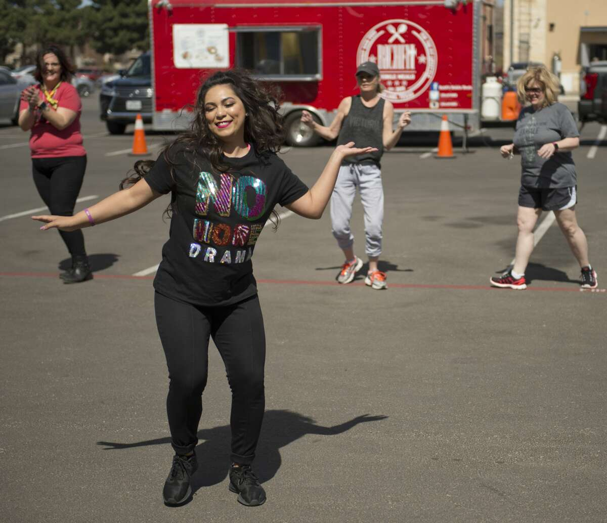 Jessica Rios leads a hip-hop to health dance session outside Clack Co Concierge Pharmacy during an open house 03/10/18. Tim Fischer/Reporter-Telegram