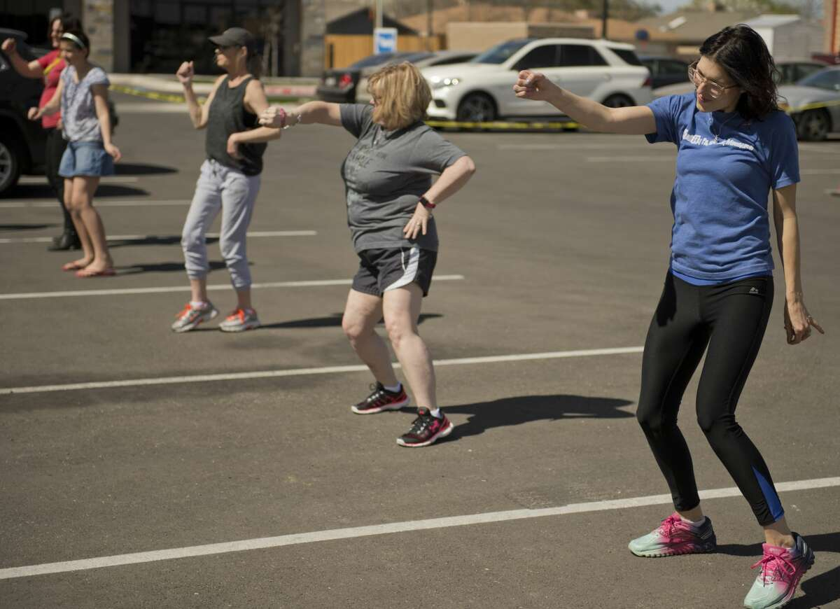 Jenna Clack, owner of Clack Co Pharmacy, joins in a hip-hop to health dance session outside Clack Co Concierge Pharmacy during an open house 03/10/18. Tim Fischer/Reporter-Telegram