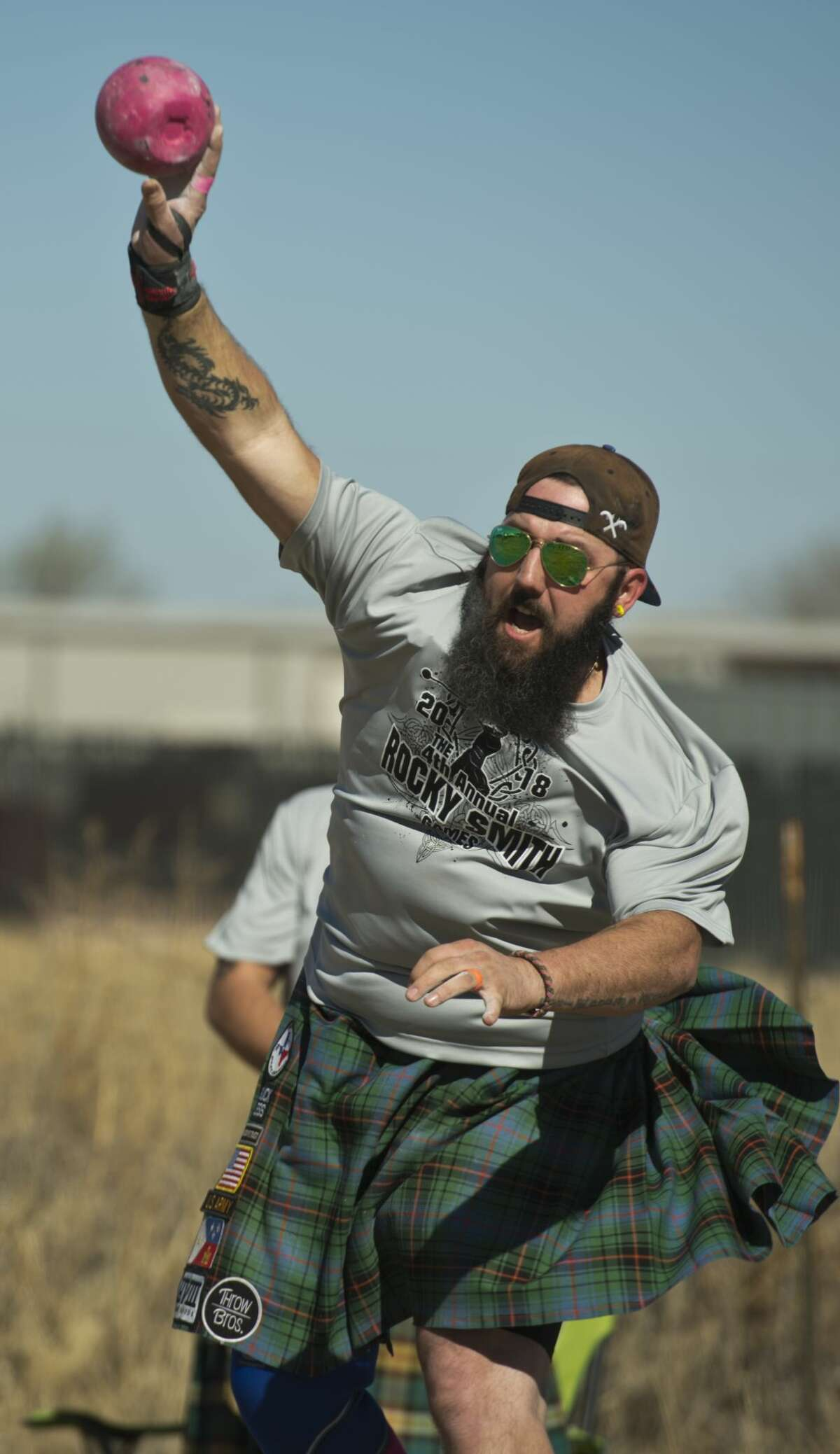 Royce Fontenot, from Yukon, Oklahoma, throws the braemar stone 03/10/18 during the 4th annual Rocky Smith Games, as part of the Highland Games during the Scottish Irish Faire at the Midland Horseshoe. Tim Fischer/Reporter-Telegram