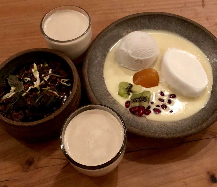 Shots of peanut milk, chocolate custard and floating island with coconut sorbet at the Progress. Photo: Michael Bauer, The Chronicle
