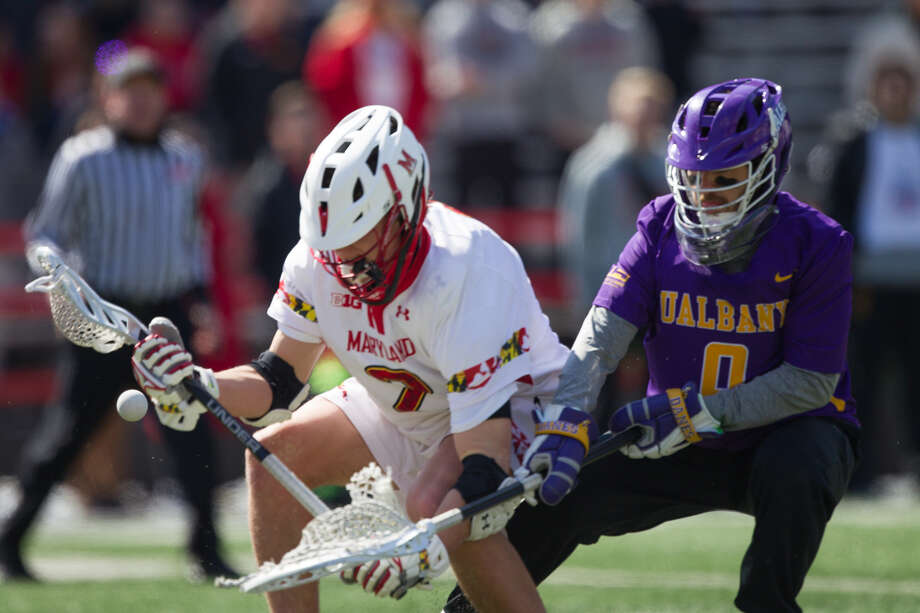 UAlbany's Davis Diamond battles with Maryland's Tim Rotanz for a ground ball during Saturday's game at Maryland Stadium. UAlbany beat Maryland 11-10. (Brian Schneider Photography)