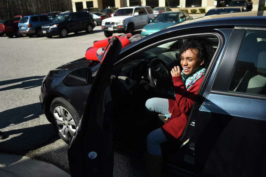 Janqueshia Gay, 27, of Baltimore sits in the Chevy she won at Destiny Church in Columbia, Md.  The goal of the free-car promotion was to drum up attendance after the church relocated. / For The Washington Post