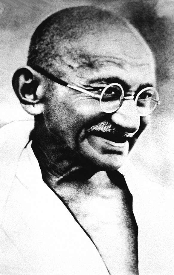 "NEW DELHI, INDIA:  Mohandas Karamchand Gandhi,  pictured in this undated file photo, who according to his great grandson Tushar Gandhi, would have despaired had he survived to see India in 1997.  The father of the nation would have judged changes brought about by 50 years of independence as a personal betrayal, Tushar says. Then, the issue was independence and today it would be a ""total lack or decay of values in public and political life.""  India celebrates its 50th Independence anniversary 15 August. Photo: -, Stringer / ONLINE_YES"