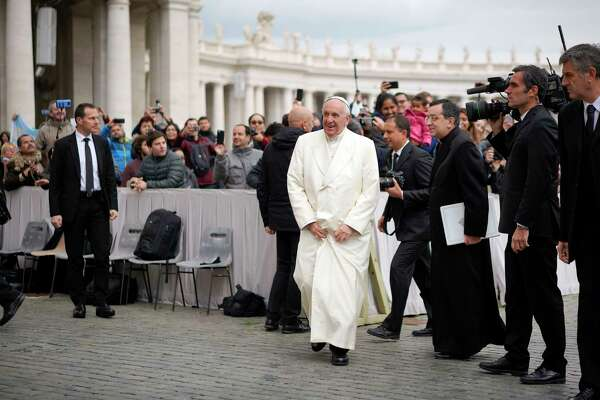"Pope Francis arrives for his weekly general audience in St. Peter's Square at the Vatican. ""Catholics who are Republican and Republican-leaning have become more negative to Pope Francis,"" said Greg Smith, one of the researchers behind a new Pew study."