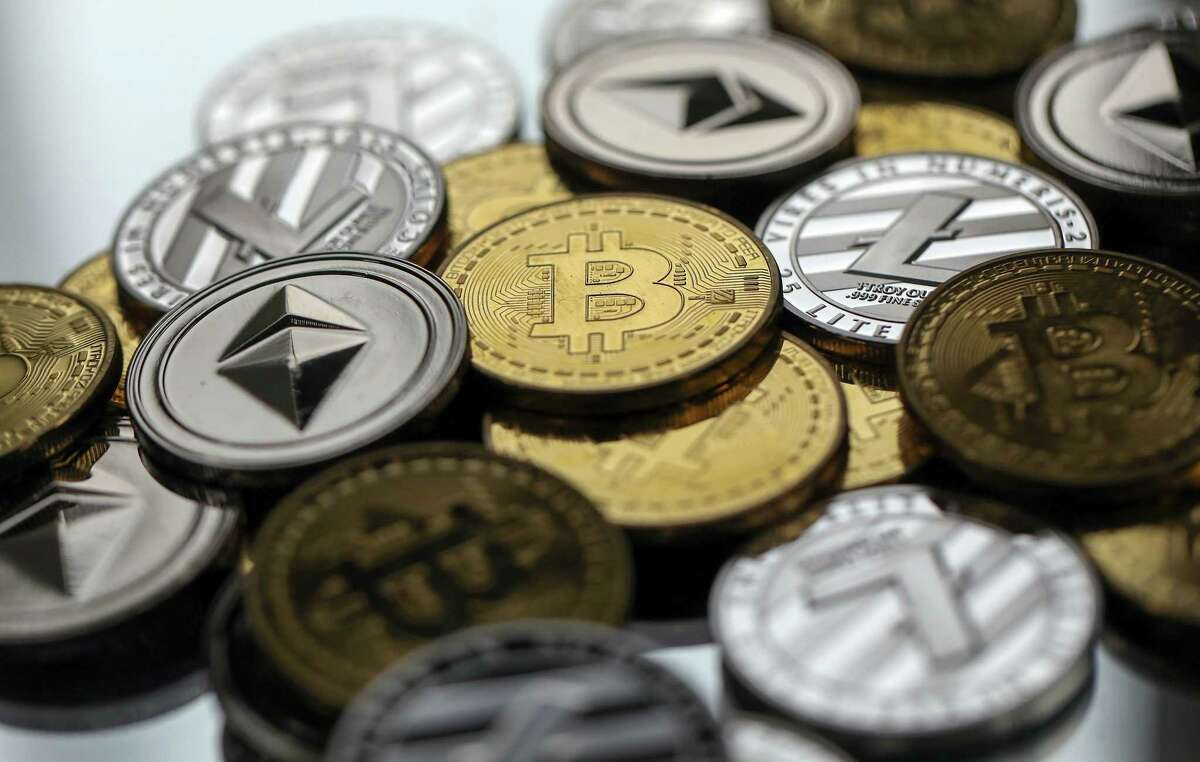 Coins representing cryptocurrencies. Google says it will not longer accept ads for virtual currencies starting in June.