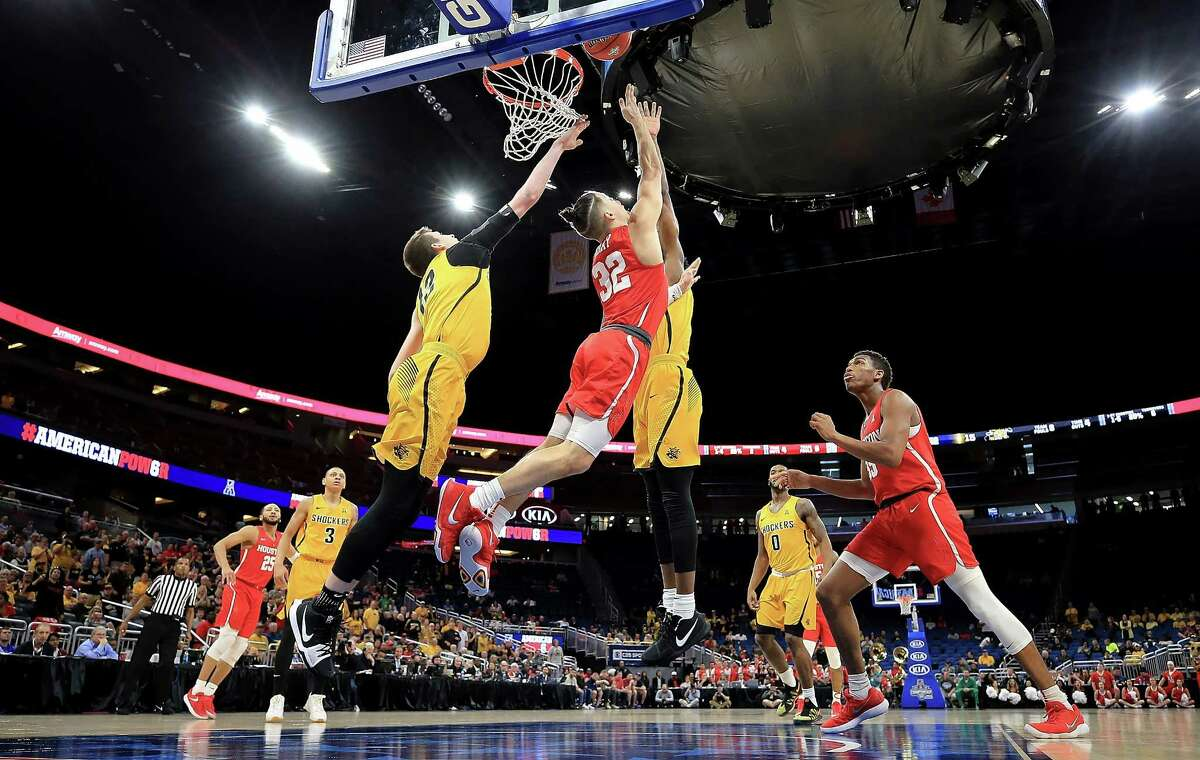 ORLANDO, FL - MARCH 10: Rob Gray #32 of the Houston Cougars drives to the basket during a semifinal game of the 2018 AAC Basketball Championship against the Wichita State Shockers at Amway Center on March 10, 2018 in Orlando, Florida.