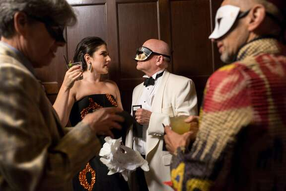Jaimie Mayer (left, middle), managing director talks to Matt Sorgenfrei (right) board chair at their Magic Theatre Masquerade Gala at Julia Morgan Ballroom, March 9, 2018, San Francisco