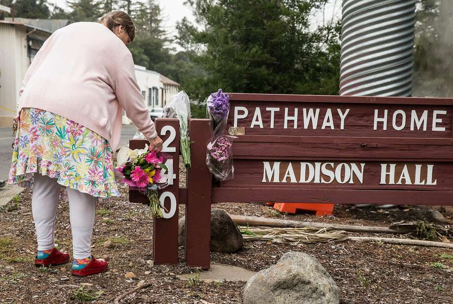 Yountville Veterans Home helper Sandra Wood Ford leaves a flower in memorial Saturday following the deadly shooting of three women at the Veterans Home of California-Yountville. Photo: Jessica Christian, The Chronicle