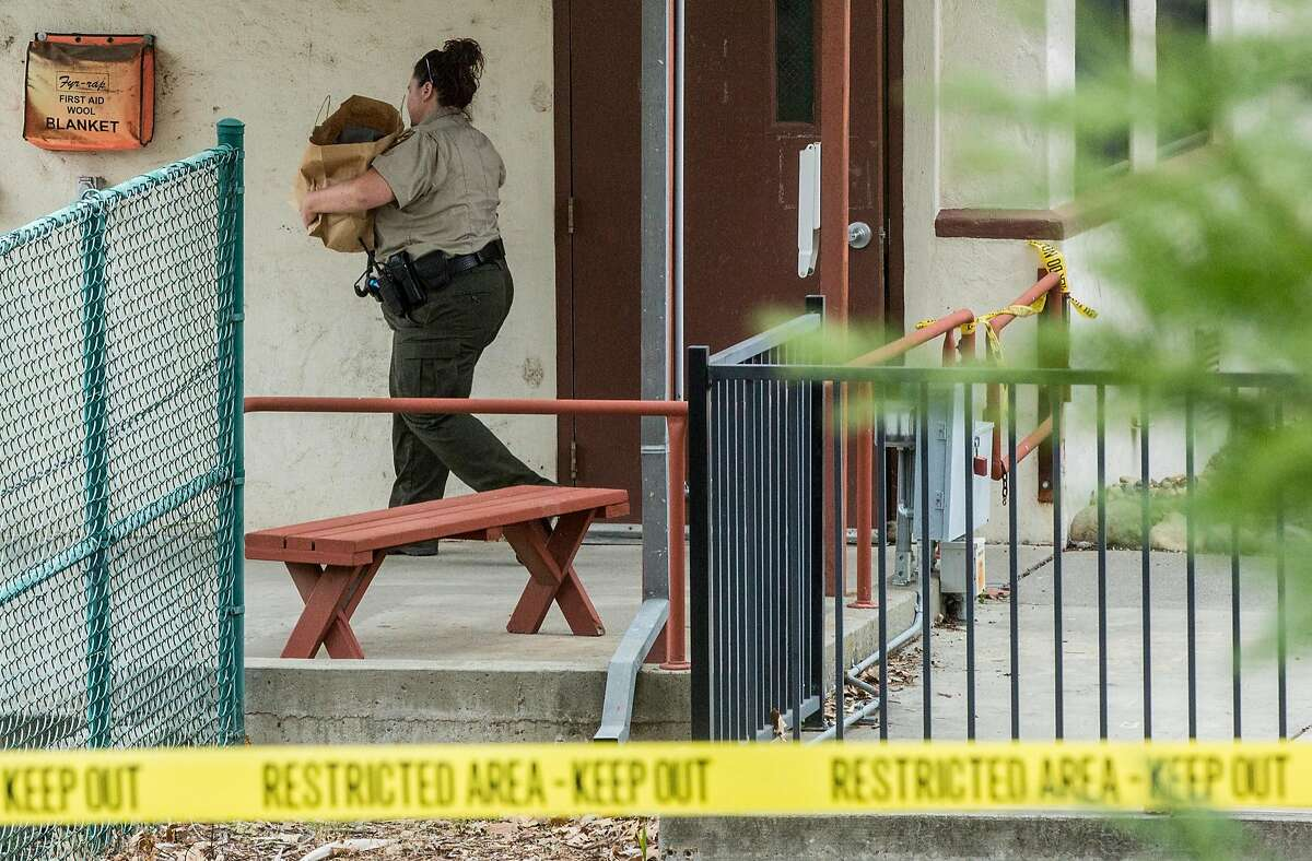 A sheriff's deputy carries out items from inside Pathway Home following the deadly shooting of three female Pathway employees by a former resident at Yountville Veterans Home of California Saturday, March 10, 2018 in Yountville, Calif.