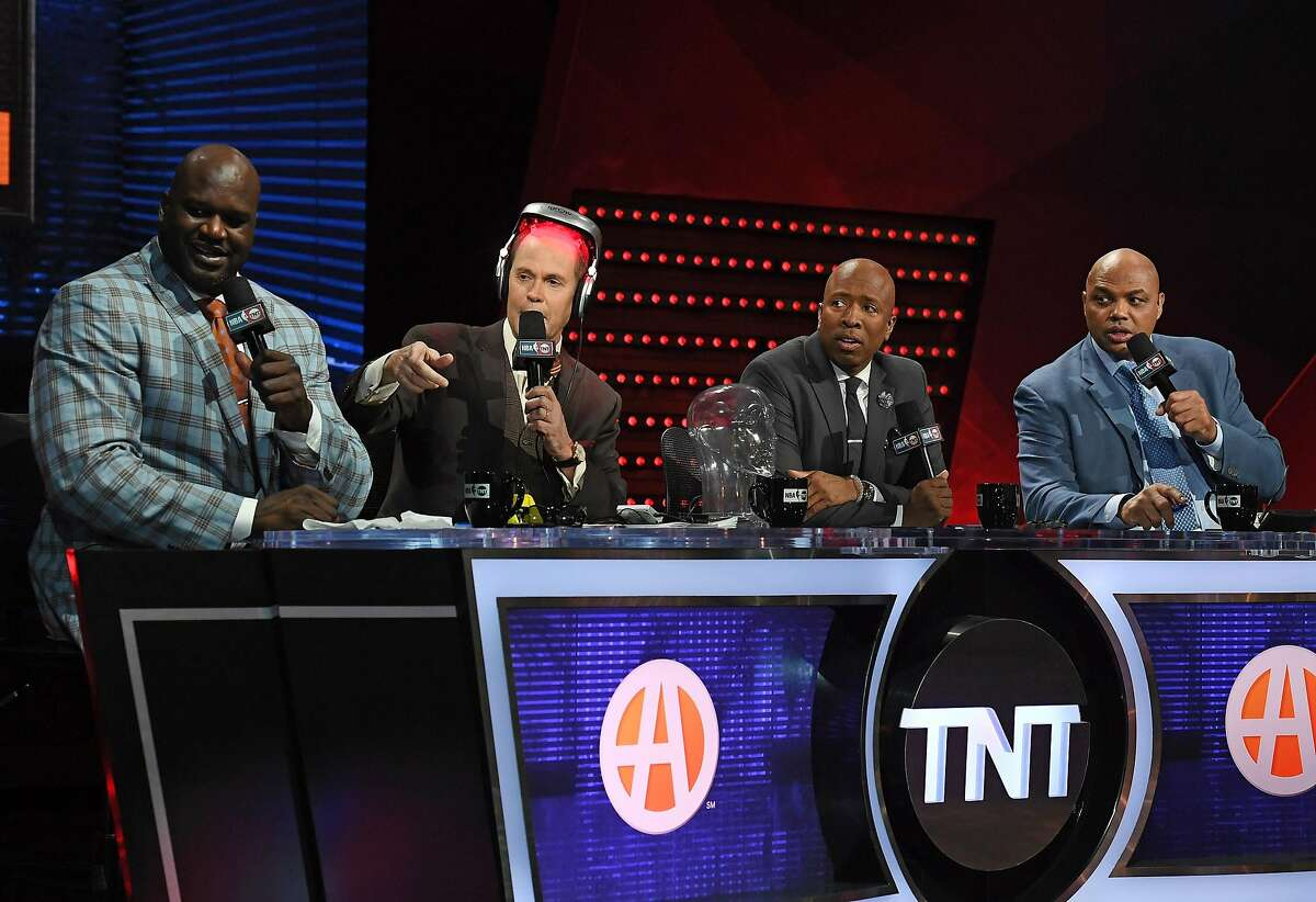 AS VEGAS, NV - JANUARY 05: TNT's Inside the NBA team (L-R) NBA analyst Shaquille O'Neal, host Ernie Johnson, wearing an iGrow laser-based hair-growth helmet, and NBA analysts Kenny Smith and Charles Barkley talk during a live telecast of 'NBA on TNT' at CES 2017 at the Sands Expo and Convention Center on January 5, 2017 in Las Vegas, Nevada. CES, the world's largest annual consumer technology trade show, runs through January 8 and features 3,800 exhibitors showing off their latest products and services to more than 165,000 attendees. (Photo by Ethan Miller/Getty Images)