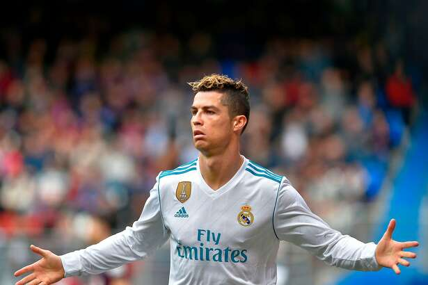 Real Madrid's Portuguese forward Cristiano Ronaldo celebrates after scoring his team's second goal during the Spanish league football match between Eibar and Real Madrid at the Ipurua stadium in Eibar on March 10, 2018. / AFP PHOTO / ANDER GILLENEAANDER GILLENEA/AFP/Getty Images