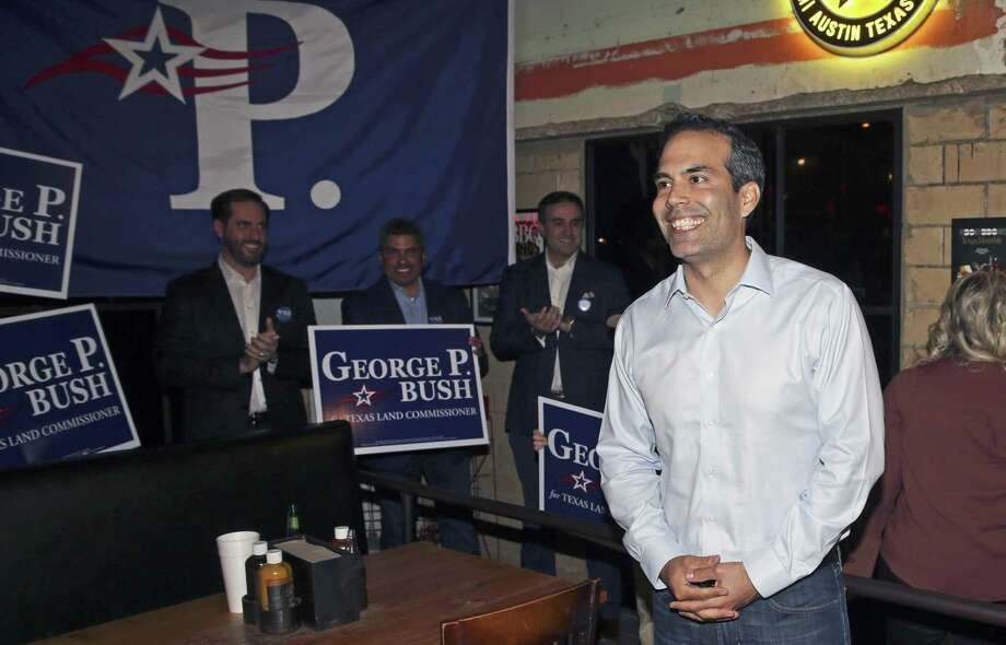 George P. Bush walks in the door at Stiles Switch BBQ to loud applause as he holds his election night watch party Tuesday in Austin. He easily won in a competitive race against fellow Republican Jerry Patterson, the previous land commissioner and a more experienced politician. Photo: Tom Reel /San Antonio Express-News / 2017 SAN ANTONIO EXPRESS-NEWS