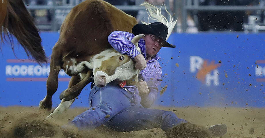 Stockton Graves wrestles a steer during the Steer Wrestling competition at the Houston Livestock Show and Rodeo at NRG Stadium, Saturday, March 10, 2018, in Houston.  ( Karen Warren / Houston Chronicle ) Photo: Karen Warren/Houston Chronicle