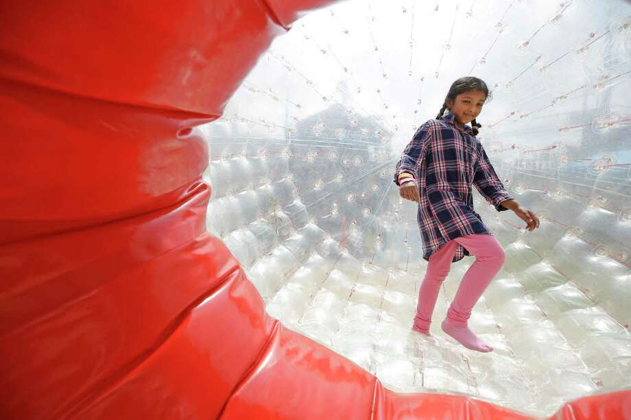 Manaan Labbey, 8, of Dallas, plays in the Human Hamster Ball at the XTreme Spring Break event at the Children's Museum of Houston, 1500 Binz St., Saturday, March 10, 2018, in Houston. Photo: Melissa Phillip, Houston Chronicle / © 2018 Houston Chronicle