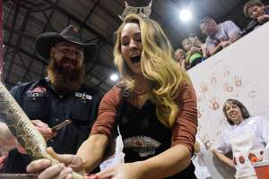 Miss Texas 2017 Margana Wood of Houston reacts as she guts a rattlesnake on Saturday, March 10, 2018, in Sweetwater, Texas.