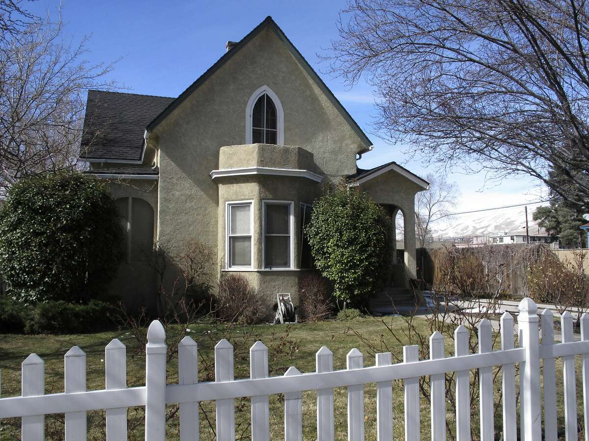 This Thursday, March 8, 2018 photo shows the Nystrsom Guest House pictured in downtown Reno, Nev. The home is one of two historic homes a developer wants to relocate for a revitalization project. Built in 1875, it was one of the first boarding houses catering to divorce-seekers who helped make Reno the ''Divorce Capital of the World'' during the 1930s because of its lax residency laws. (AP Photo/Scott Sonner)