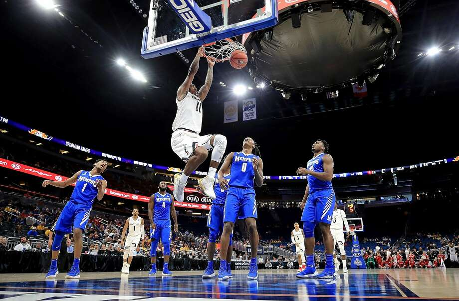 Cincinnati's Gary Clark slams home two of his 17 points in a win against Memphis. Photo: Mike Ehrmann, Getty Images