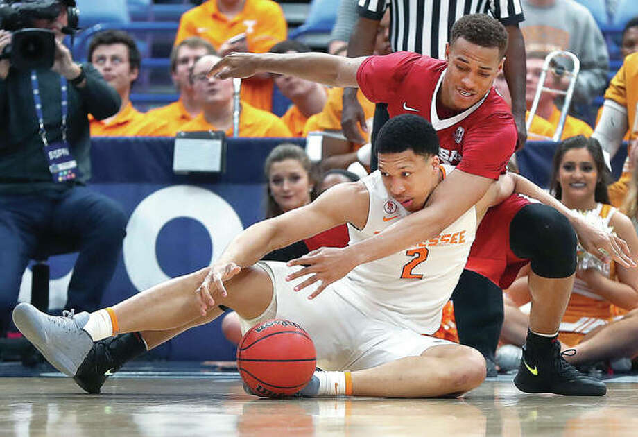 Tennessee's Grant Williams (2) and Arkansas' Daniel Gafford reach for a loose ball in Saturday's semifinal of the SEC Tournament in St. Louis. Tennessee won 84-66. Photo: AP