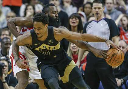 2d1dc178bd8e Rockets guard James Harden (rear) knocks the ball from Raptors guard DeMar  DeRozan in the second half Friday in Toronto. The two grew up as friends  and ...