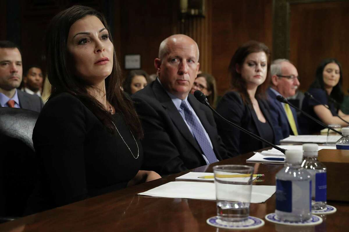 Former gymnast Jamie Dantzscher, US Olympic Committee Paralympic Sport and National Governing Body Chief Rick Adams, Stafford County Commonwealth's Attorney Eric Olsen, three-time Rhythmic Gymnastics National Champion Jessica Howard and 1996 Olympic Gold Medalist Dominique Moceanu testify before the Senate Judiciary Committee during a hearing about sexual, emotional and physical abuse by USA Gymnastics officials in the Dirksen Senate Office Building on Capitol Hill March 28, 2017 in Washington, DC.