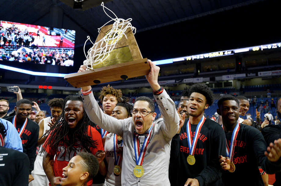 Memorial coach Kenneth Coleman hoists the trophy after the Titans defeated Northwest in the class 5A state final at the Alamodome in San Antonio on Saturday afternoon.   Photo taken Saturday 3/10/18 Ryan Pelham/The Enterprise Photo: Ryan Pelham / ©2017 The Beaumont Enterprise/Ryan Pelham