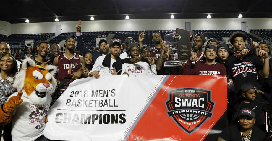 The Texas Southern Tigers celebrate with the Championship Trophy after the SWAC Basketball Tournament Championship Game at Delmar Field House in Houston, TX on Saturday, March 10, 2018. Photo: Tim Warner/For The Chronicle