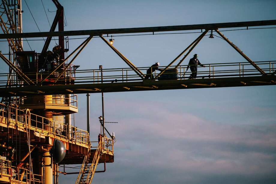 Workers aboard an oil and gas platform run by Energy XXI in the Gulf of Mexico, south of Port Fourchon, La. Energy XXI, which has been cited for workplace safety violations at a rate much higher than the industry average, is among the companies benefitting from the Trump administrations efforts to upend financial, environmental and safety regulations. Photo: CHRIS CARMICHAEL / Chris Carmichael / New York Times / NYTNS
