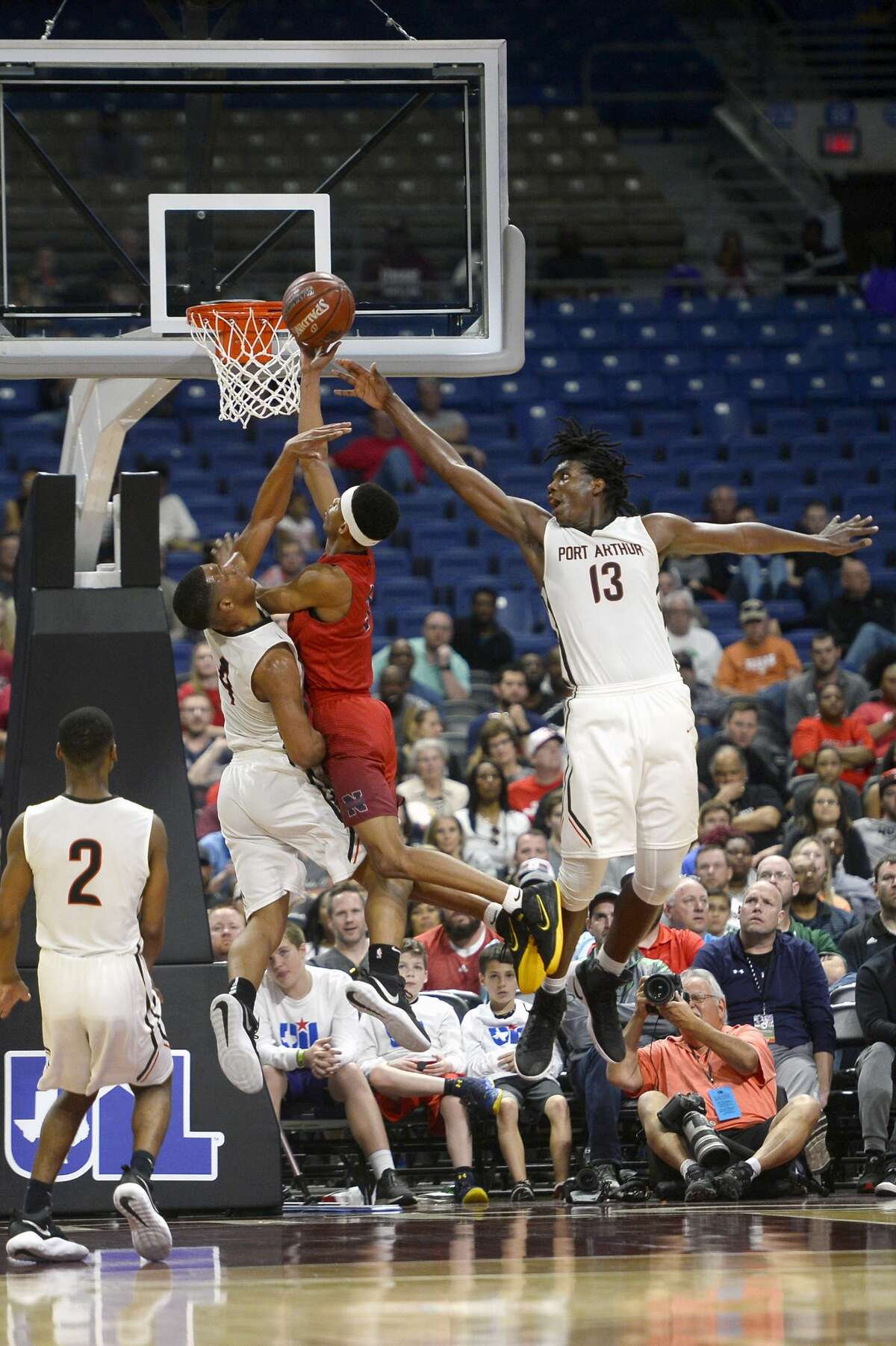 Memorial's Darion Chatman and Nathan Clover defend a shot against Northwest in the class 5A state final at the Alamodome in San Antonio on Saturday afternoon. Photo taken Saturday 3/10/18 Ryan Pelham/The Enterprise