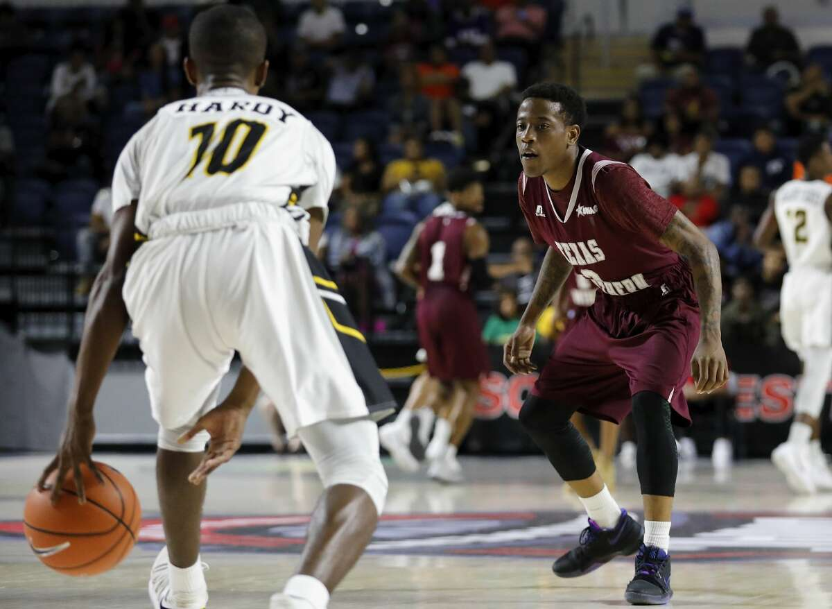 Texas Southern Tigers guard Demontrae Jefferson (3) defends Arkansas-Pine Bluff Golden Lions guard Quamauri Hardy (10) in the second half during the SWAC Basketball Tournament Championship Game at Delmar Field House in Houston, TX on Saturday, March 10, 2018.