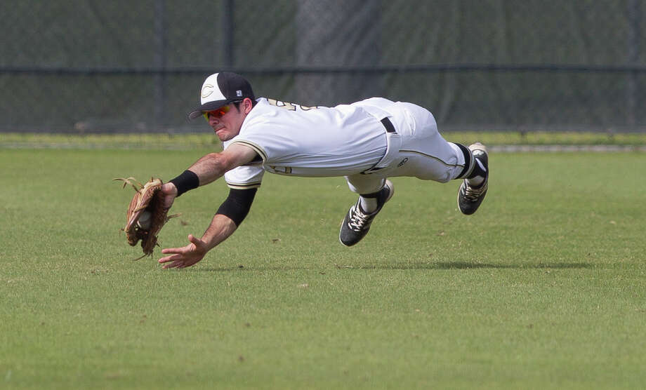Conroe left fielder Charles Dinaso (5) makes a diving play on Tomball Memorial Alex Quarfordt's line drive in the first inning of a game during the Klein Tomball Tournament, Saturday, March 10, 2018, in Tomball. Photo: Jason Fochtman/Houston Chronicle