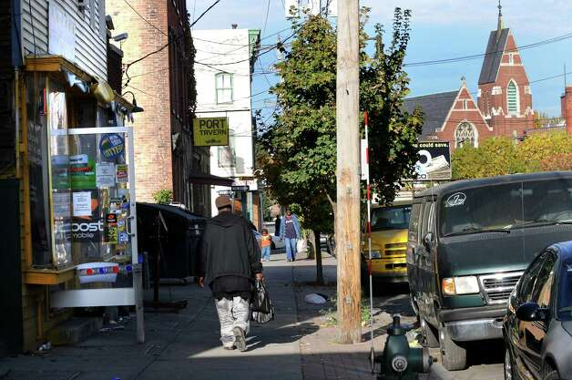 City residents walk by the yellow store, left, and the Port Tavern on Thursday, Oct. 22, 2009, on South Pearl Street in Albany, N.Y. (Cindy Schultz / Times Union) Photo: CINDY SCHULTZ