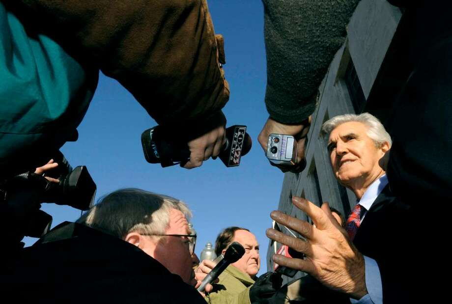 Former state Sen. Joseph Bruno , right, speaks to the media outside the federal court house during a break in his 2009 trial in Albany. (Michael P. Farrell/ Times Union) Photo: MICHAEL P. FARRELL / 00006467A