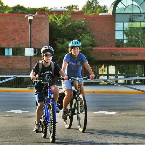 Student Adam Marino, left, 12, rides his bike home from school Thursday afternoon Sept. 24, 2009, accompanied by his mother, Janette Kaddo Marino.  (John Carl D'Annibale / Times Union) Photo: John Carl D'Annibale / 00005648A