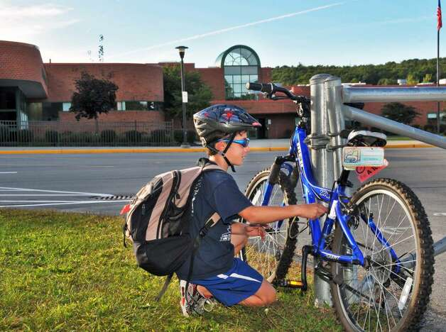 Student Adam Marino, 12, unlocks his bike before riding home from school Thursday afternoon Sept. 24, 2009.  (John Carl D'Annibale / Times Union) Photo: John Carl D'Annibale / 00005648A