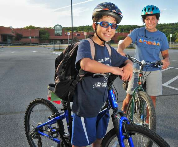 Student Adam Marino, left, 12, prepares to ride his bike home from school Thursday afternoon Sept. 24, 2009, accompanied by his mother, Janette Kaddo Marino.  (John Carl D'Annibale / Times Union) Photo: John Carl D'Annibale / 00005648A