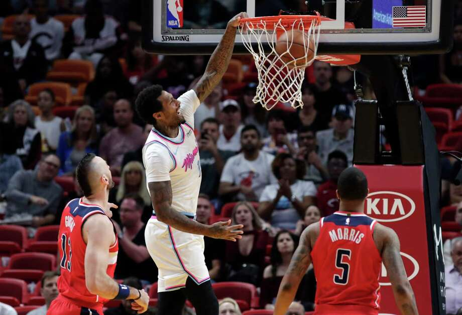 The Heat's James Johnson slams one home as the Wizards' Markieff Morris, right, looks on Saturday. Photo: Lynne Sladky, STF / Copyright 2018 The Associated Press. All rights reserved.
