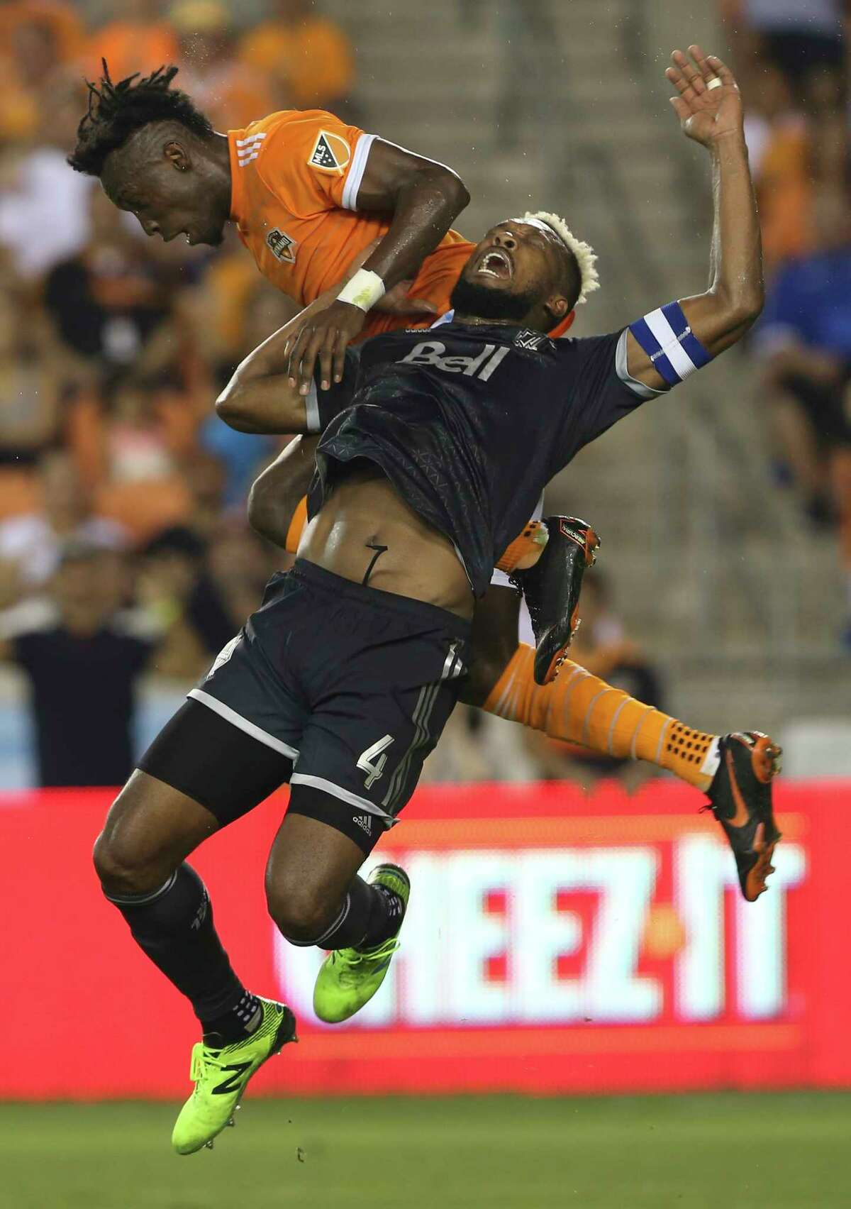 Houston Dynamo forward Alberth Elis (17) and Vancouver Whitecaps defender Kendall Waston (4) go up for a header during the second half of the MLS game at BBVA Compass Stadium on Saturday, March 10, 2018, in Houston. The Houston Dynamo lost to the Vancouver Whitecaps 2-1. ( Yi-Chin Lee / Houston Chronicle )