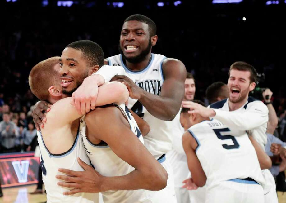 Villanova's Donte DiVincenzo, left, Mikal Bridges, Eric Paschall, right, and teammates celebrate after their victory. Photo: Frank Franklin II, STF / Copyright 2018 The Associated Press. All rights reserved.