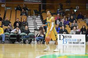 Xavier Moon of the Albany Patroons moves the ball up the court against Yakima at the Washington Avenue Armory in Albany on Feb. 25, 2018. (Leif Skodnick/Times Union)