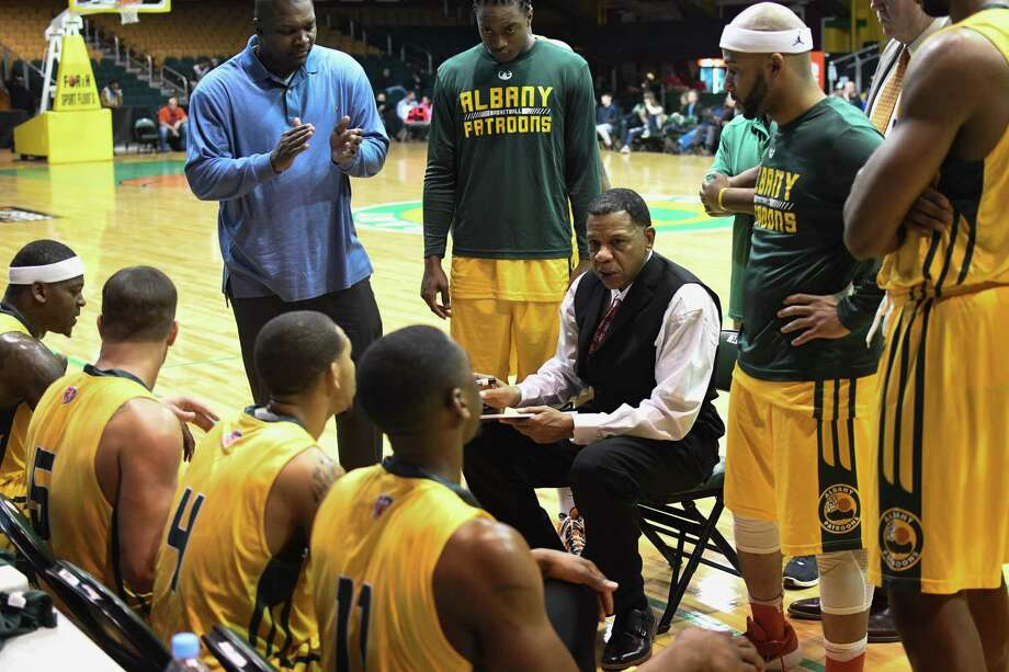 Albany Patroons players listen as head coach Derrick Rowland talks about a play at a timeout during a game against Ohio Cardinals on Saturday, Feb. 17, 2018, at Washington Avenue Armory in Albany, N.Y. (Jenn March/Special to the Times Union) Photo: Jenn March / © Jenn March 2017-18 © Albany Times Union 2017-18