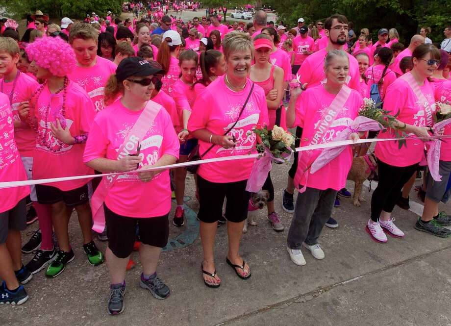 Edith McLeughlin, center, shares a laugh with fellow breast cancer survivor Ina Patton, right, during the annual Paint the Path Pink run in 2017 in Conroe. The event raises money for breast cancer awareness, diagnosis, treatment and research. Photo: Jason Fochtman, Staff Photographer / © 2017 Houston Chronicle