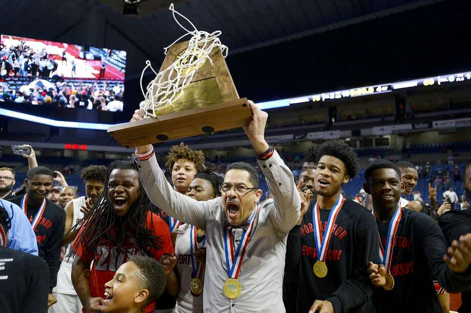 Memorial coach Kenneth Coleman hoists the trophy after the Titans defeated Northwest in the class 5A state final at the Alamodome in San Antonio on Saturday afternoon.   Photo taken Saturday 3/10/18 Ryan Pelham/The Enterprise Photo: Ryan Pelham / Ryan Pelham/The Enterprise / ©2017 The Beaumont Enterprise/Ryan Pelham
