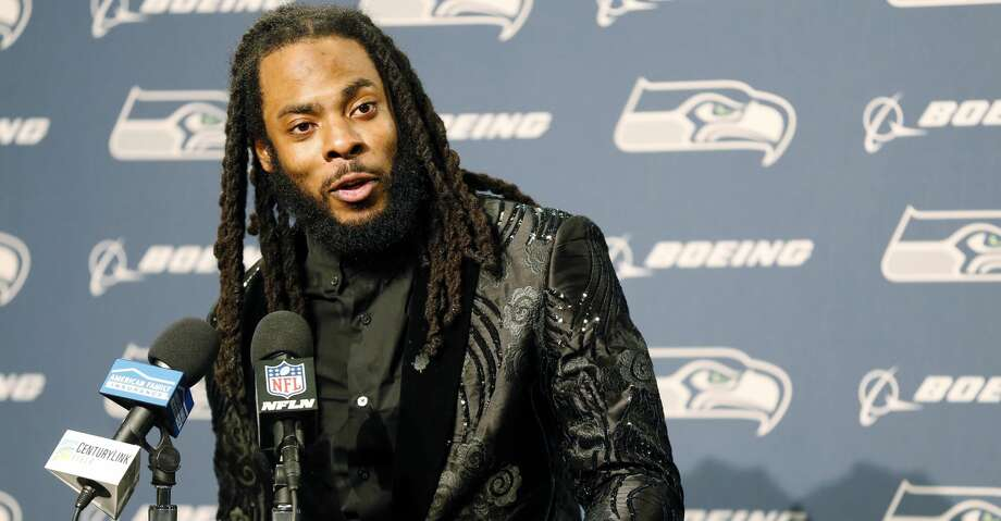 FILE - In this Oct. 29, 2017, file photo, Seattle Seahawks cornerback Richard Sherman talks to reporters during a post-game press conference following an NFL football game against the Houston Texans, in Seattle. The Seahawks are cutting ties with star cornerback Richard Sherman after seven seasons. The team has informed him that he will be released, and Sherman confirmed the decision in a text message to The Associated Press on Friday, March 9, 2018. (AP Photo/Stephen Brashear, File) Photo: Stephen Brashear/Associated Press