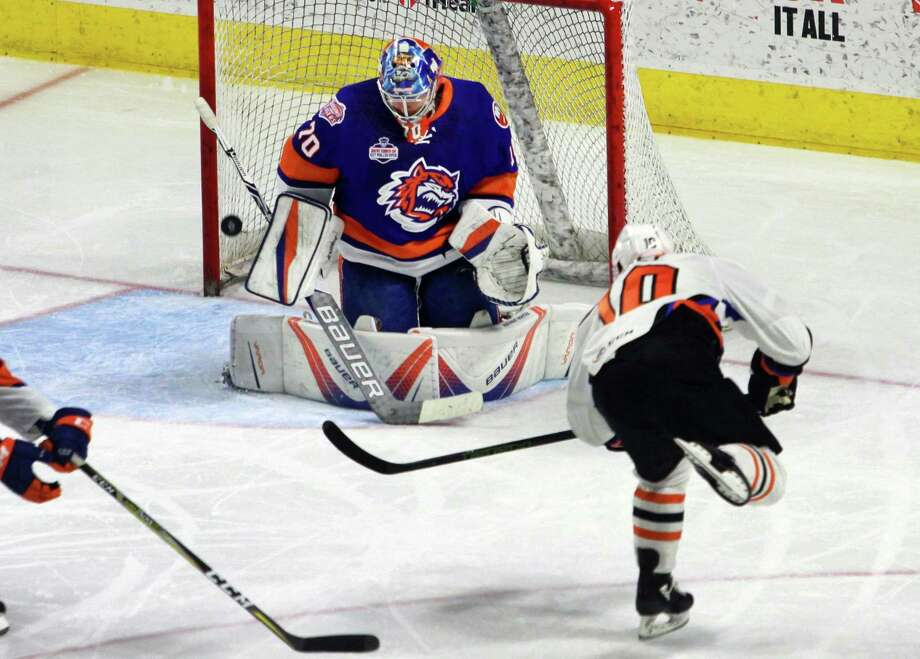 Sound Tigers goalie Kristers Gudlevskis fails to stop a shot by Lehigh Valley's Greg Carey during AHL hockey action at the Webster Bank Arena in Bridgeport, Conn. on Saturday Mar. 10, 2018. Photo: Christian Abraham / Hearst Connecticut Media / Connecticut Post
