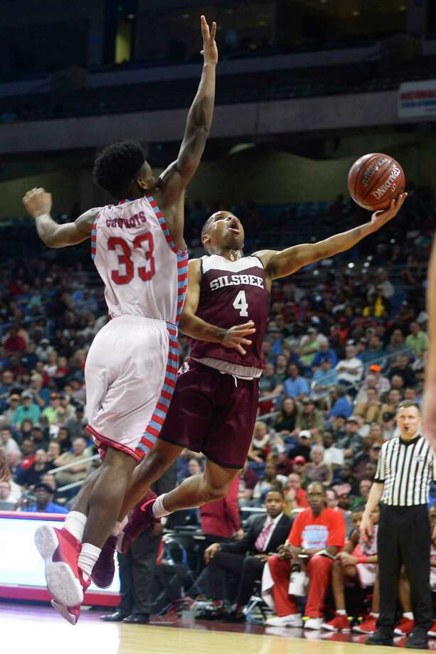 Silsbee's Braelon Bush takes a layup against Dallas Carter's Kyree Rogers in the class 4A state final at the Alamodome in San Antonio on Saturday afternoon.   Photo taken Saturday 3/10/18 Ryan Pelham/The Enterprise Photo: Ryan Pelham / ©2017 The Beaumont Enterprise/Ryan Pelham