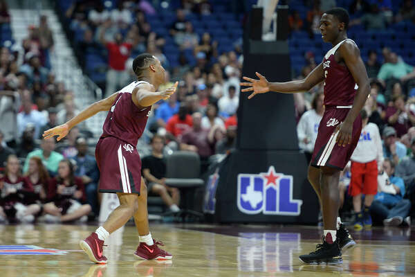 Silsbee's Braelon Bush high fives teammate Landyn Tyler as they take on Dallas Carter in the class 4A state final at the Alamodome in San Antonio on Saturday afternoon. Photo taken Saturday 3/10/18 Ryan Pelham/The Enterprise