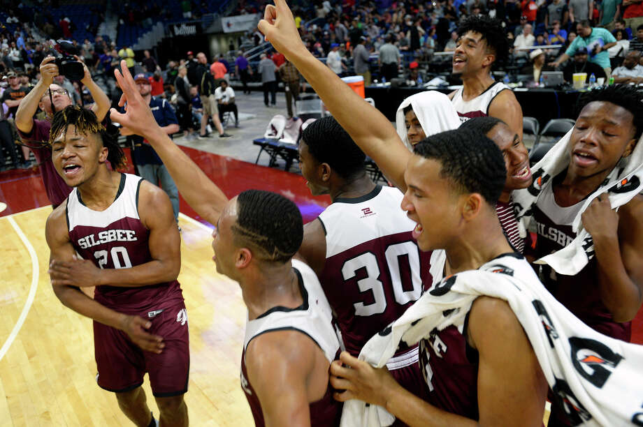 Silsbee players celebrate after beating Dallas Carter in the class 4A state final at the Alamodome in San Antonio on Saturday afternoon.   Photo taken Saturday 3/10/18 Ryan Pelham/The Enterprise Photo: Ryan Pelham / ©2017 The Beaumont Enterprise/Ryan Pelham