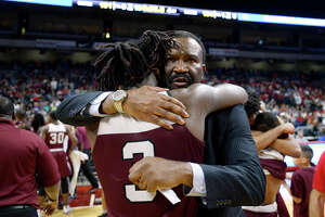 Silsbee's Devon McCain hugs coach Joe Sigler after beating Dallas Carter in the class 4A state final at the Alamodome in San Antonio on Saturday afternoon.   Photo taken Saturday 3/10/18 Ryan Pelham/The Enterprise