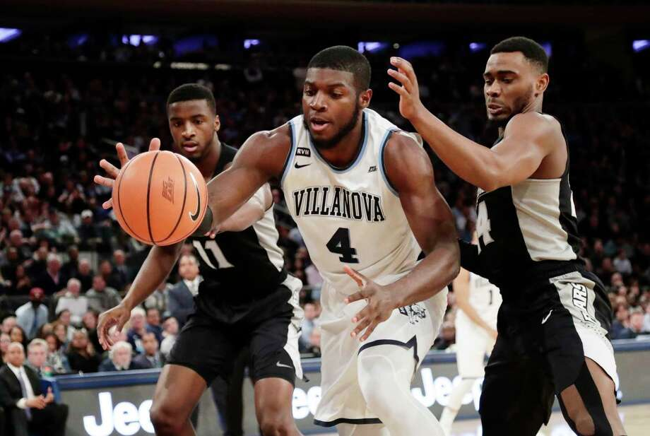 Providence's Kyron Cartwright (24) and Alpha Diallo (11) defend against Villanova's Eric Paschall (4) during the first half of an NCAA college basketball game in the Big East men's tournament final Saturday, March 10, 2018, in New York. Photo: Frank Franklin II, AP / Copyright 2018 The Associated Press. All rights reserved.