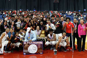 Memorial poses with their hardware after beating Northwest in the class 5A state final at the Alamodome in San Antonio on Saturday afternoon.   Photo taken Saturday 3/10/18 Ryan Pelham/The Enterprise
